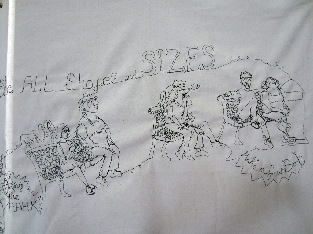 People of all shapes and sizes were sewn onto a white fabric.
