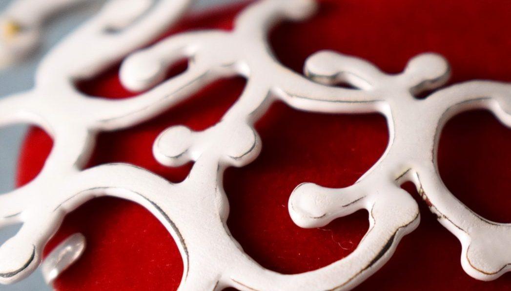 red flocking and white enamel swirl pattern