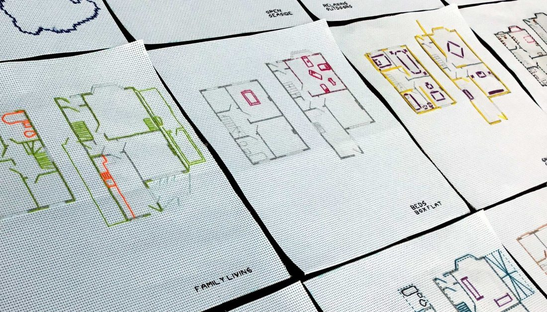 Stitched diagrams of various rooms on to fabric.