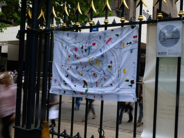 The finish map with many colorful applications was hung up at a fence