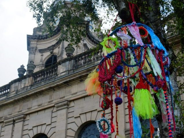 the large-scale brightly coloured chandelier was hung up in the tree in front of the Cathedral