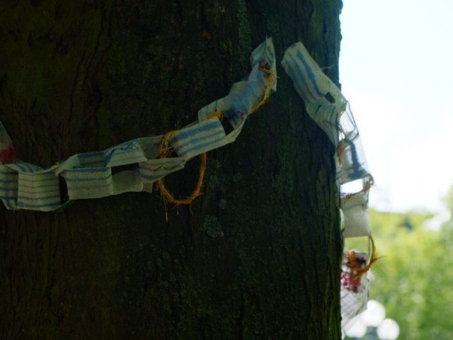 chain made of fabric strips, on which passers-by could write or paint something