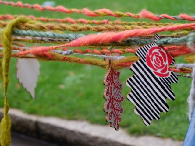 Passersby spun their own length of wool and attached it to the length of yarn using balsa wood tags.