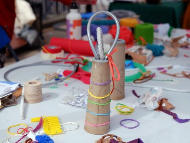 A paper cone with colorful rubbers around it.