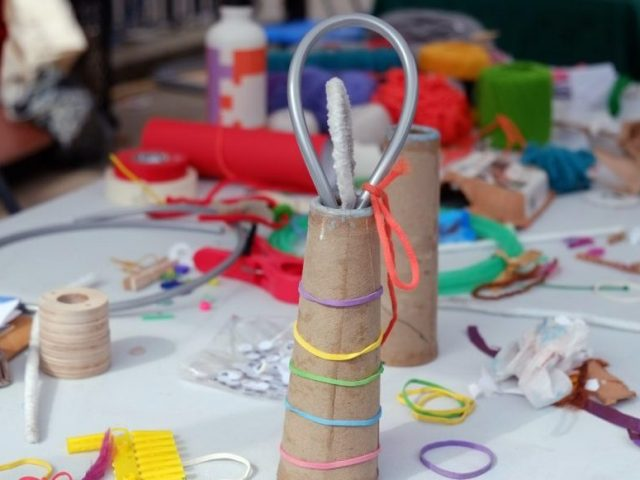 A paper cone with colourful elastic around it.