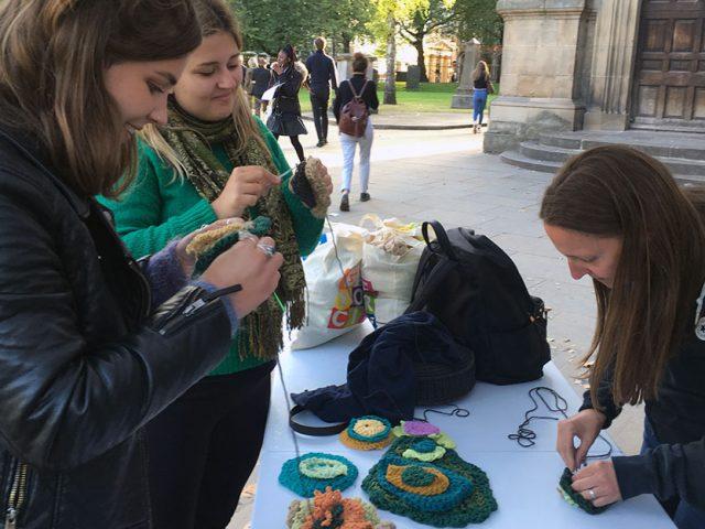 three women crocheting