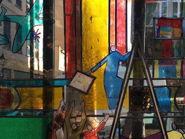 artwork with figures passing panes of glass up a ladder