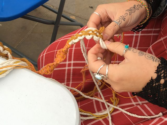 hands macrame knotting cord