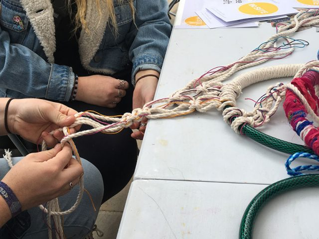 hands knotting cord