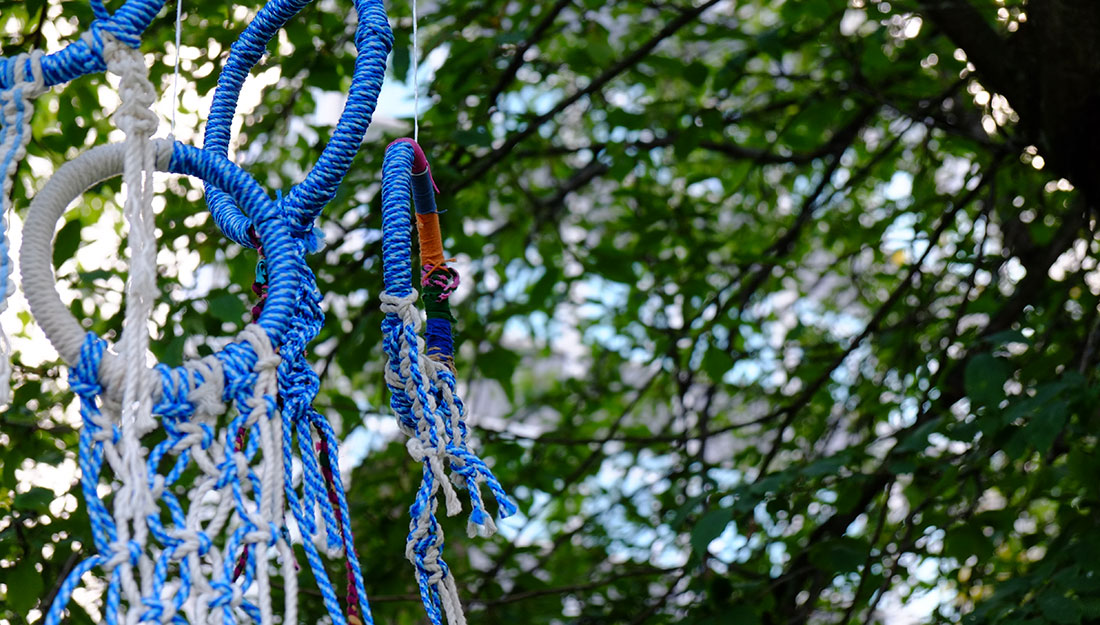 knotted macrame hoops hanging in tree