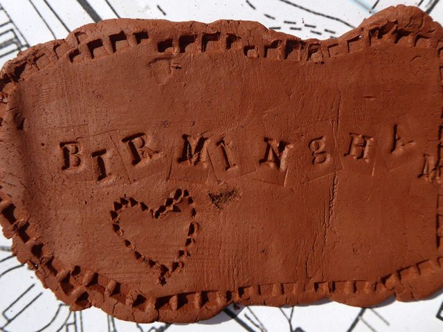 BIRMINGHAM and a heart stamped in clay