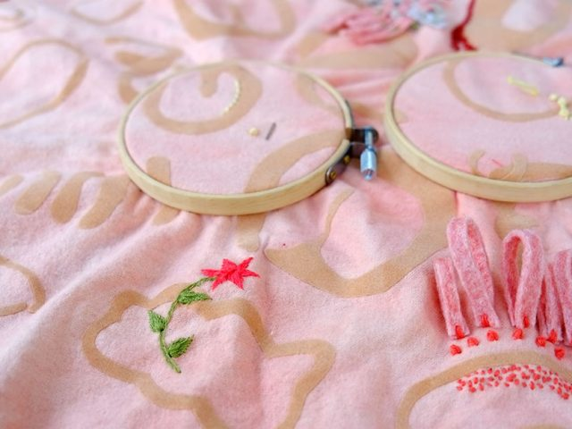 embroidery and embroidery hoops on a soft piece of material