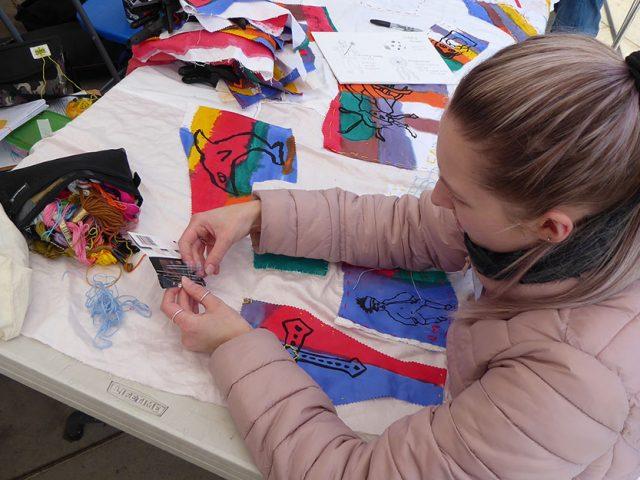 volunteer stitching fabric