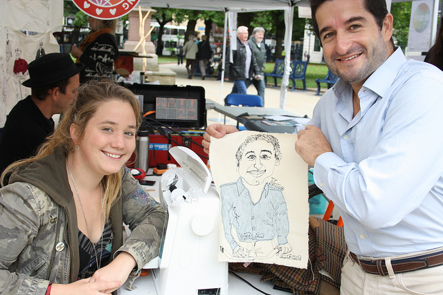 The artist sewed the picture of the man next to her.