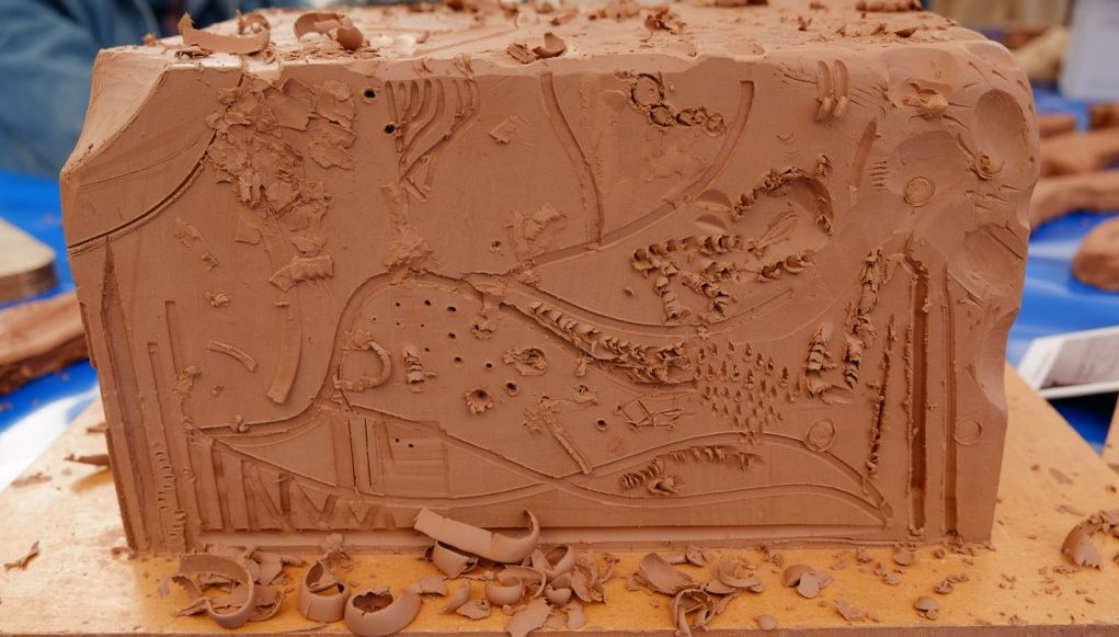 A big clay block on which participants carved various patterns.