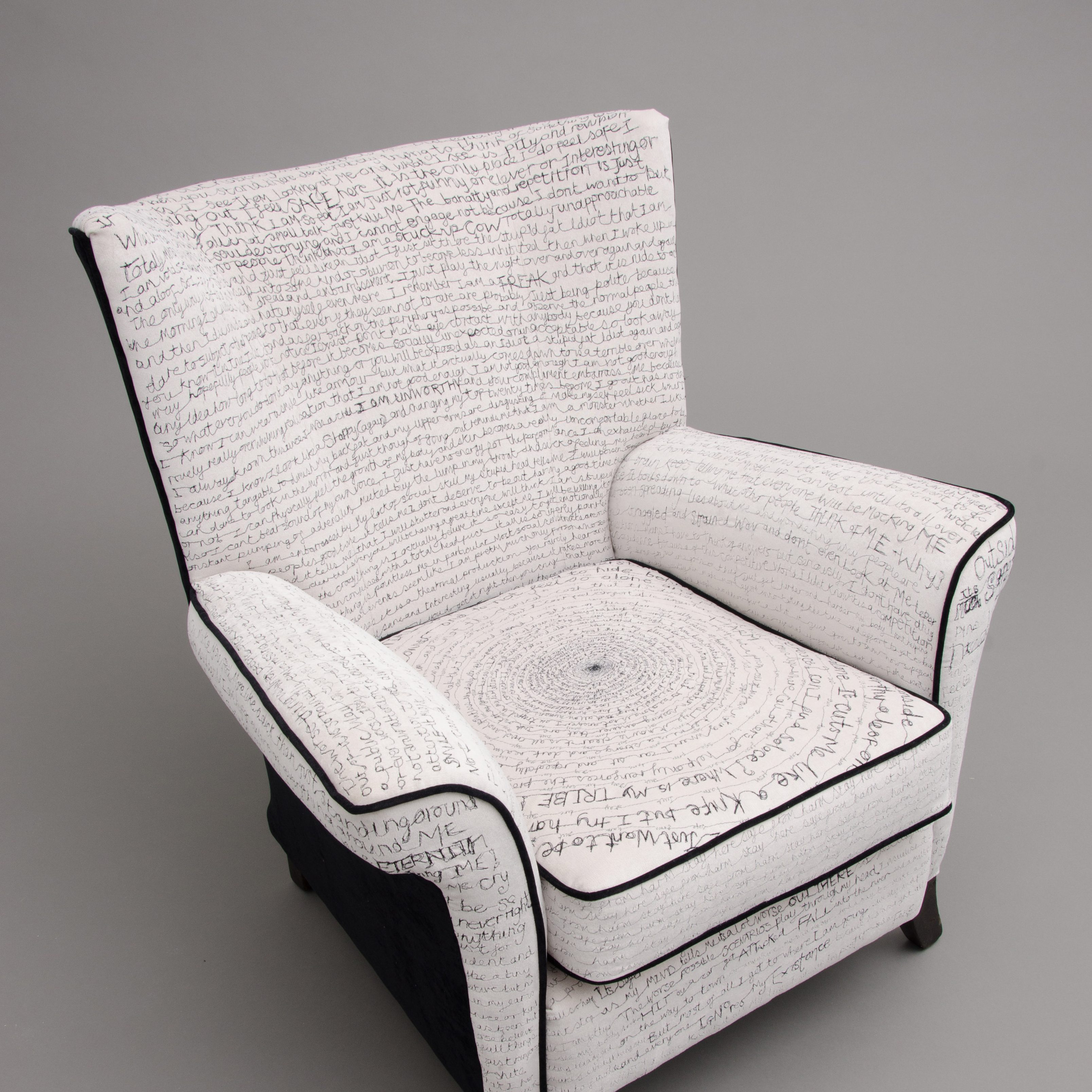 chair with stitched words