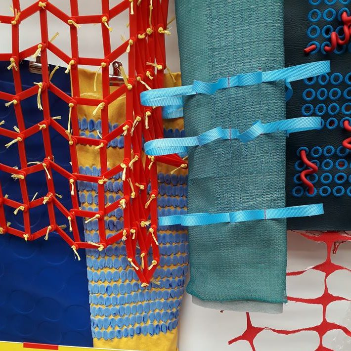 Various colourful materials stitched into using threads and cords.