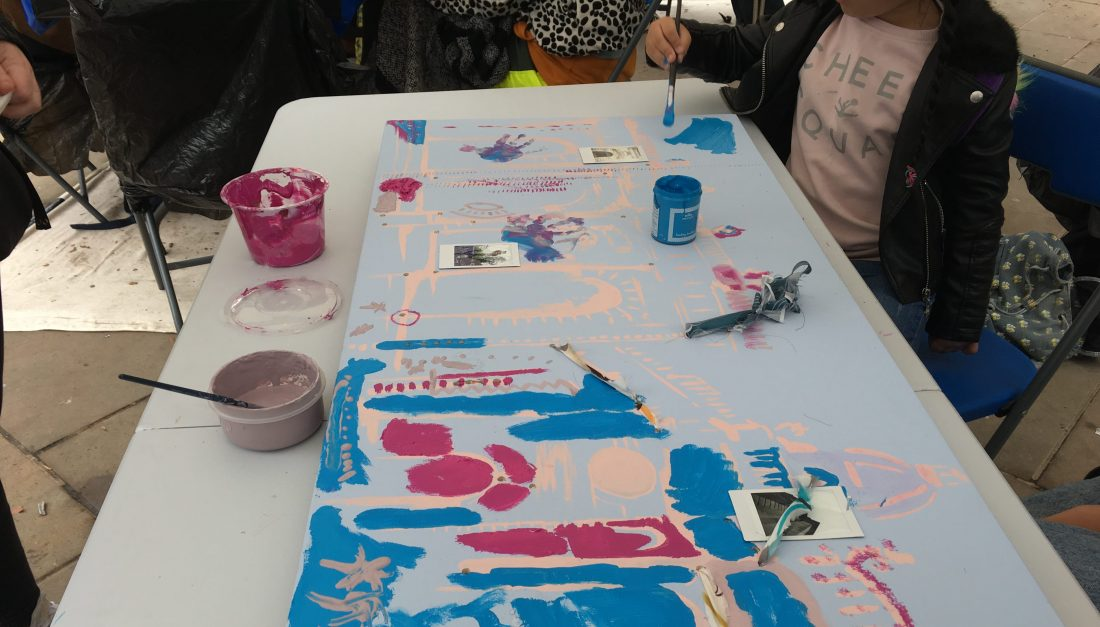 A child is painting the surrounding of the Cathedral Square in bright colours.