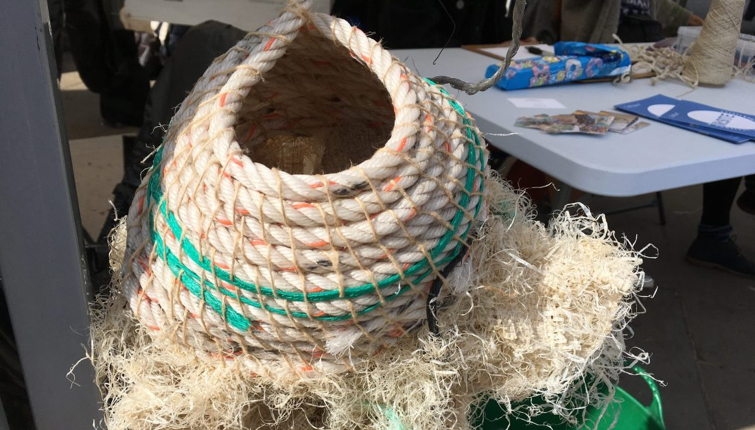 A large hand embroidered sculptures with beach debris such as fishing nets.