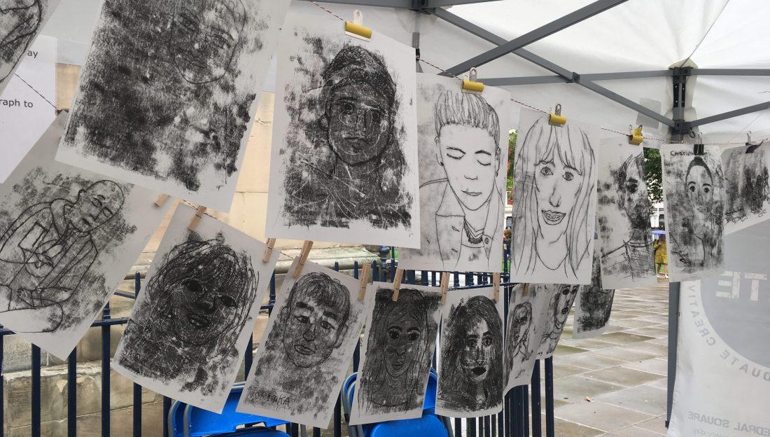 Monoprint portraits hanging on a line