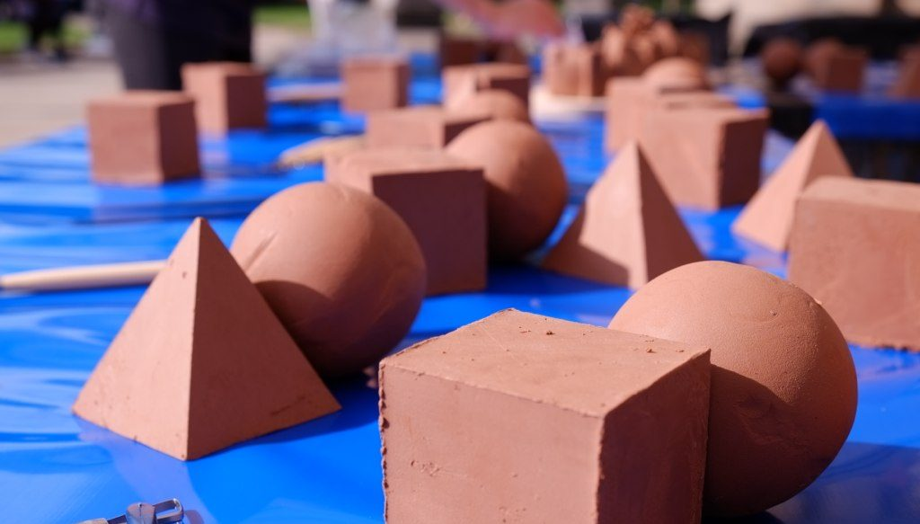 table of industrial clay blanks as cubes, pyramids and spheres.