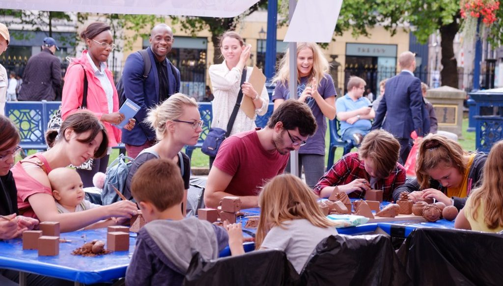 The public were intrigued by watching participants sculpt with clay