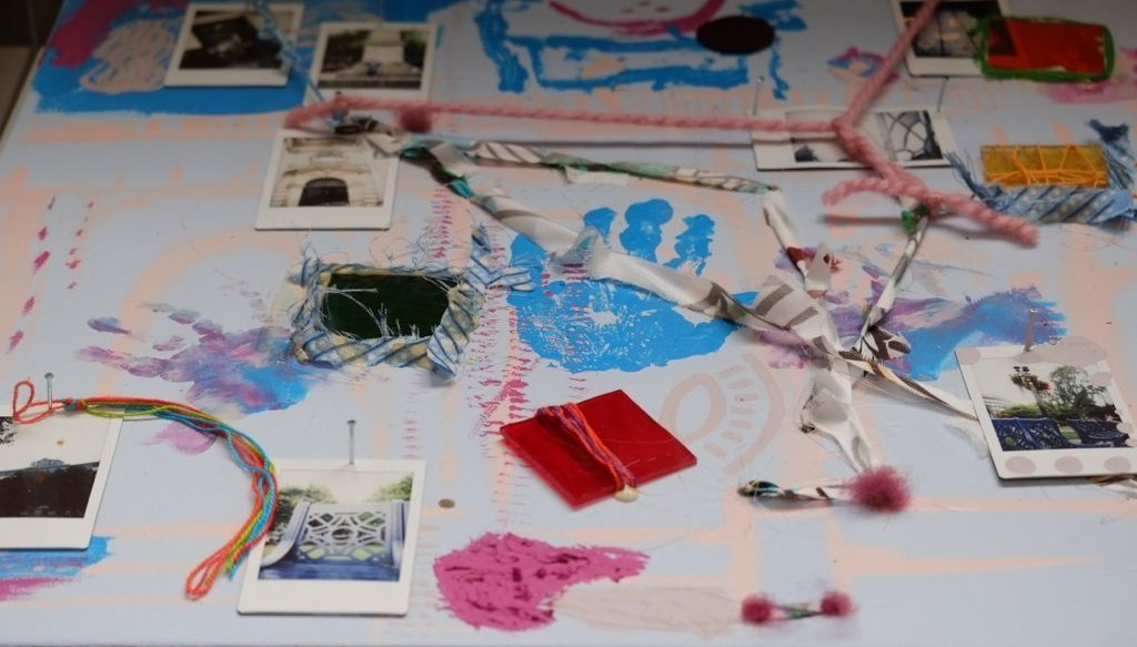 The map of the Cathedral square with colorful textiles, polaroid photographs and wool threads.
