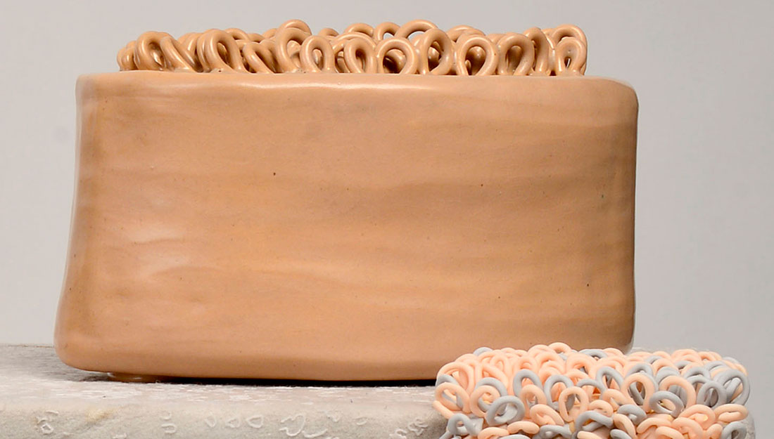 sculptural block object with many loops on top made from polymer clay