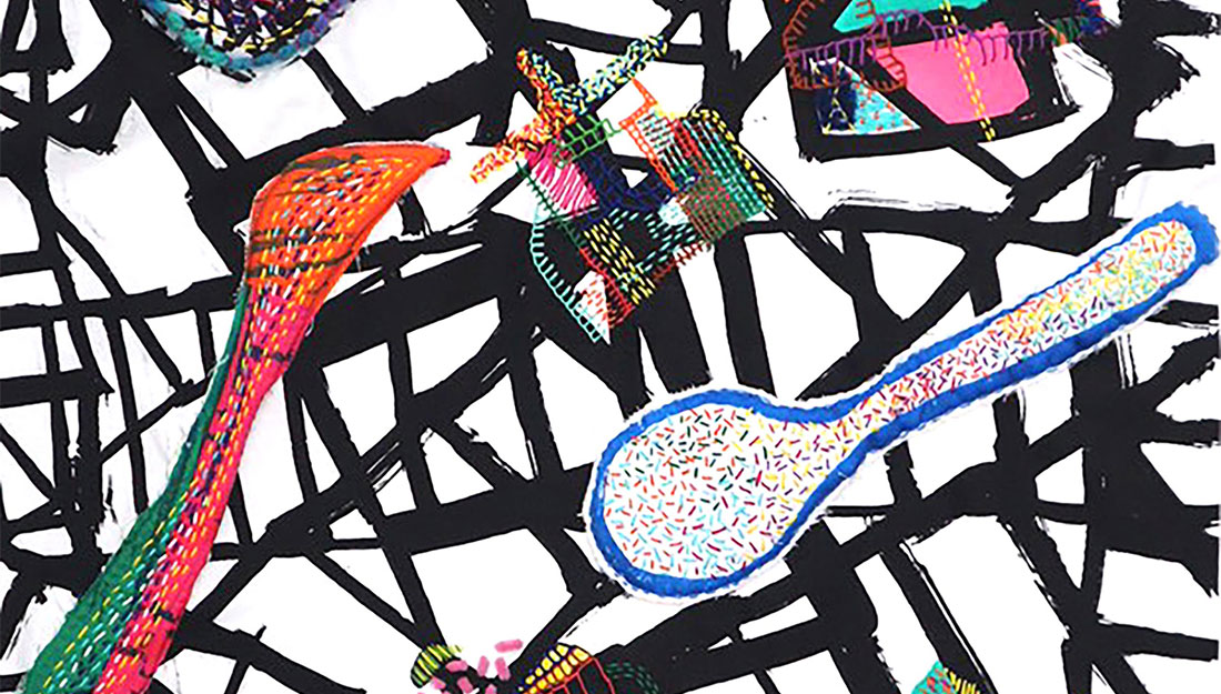 colourful fabric shapes stitched on a graphic background