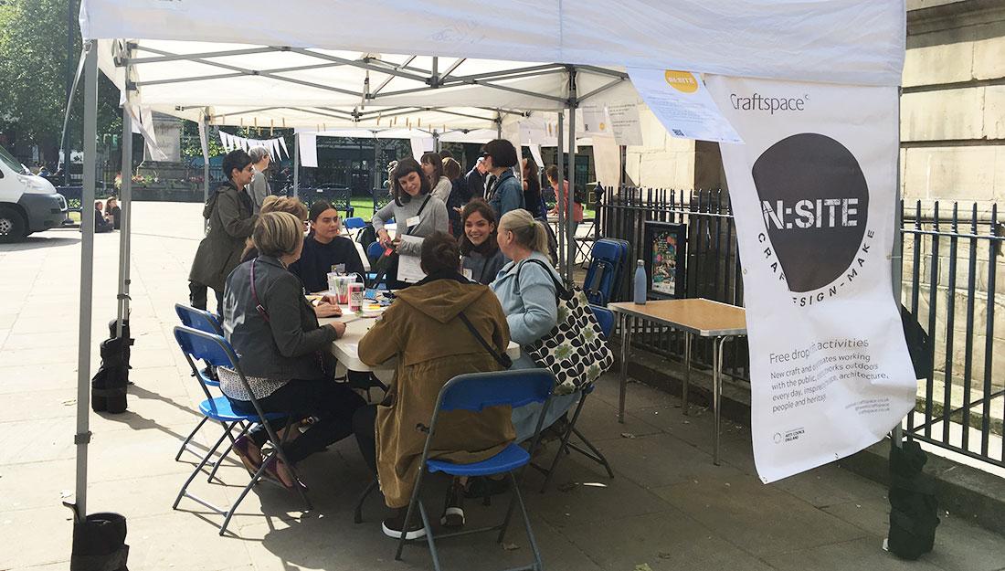 groups of people gathered around table under gazebo