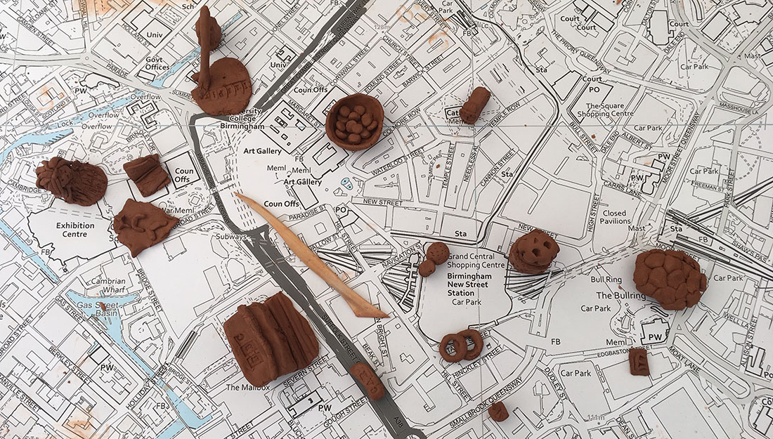 small clay onjects on a map of Birmingham city centre
